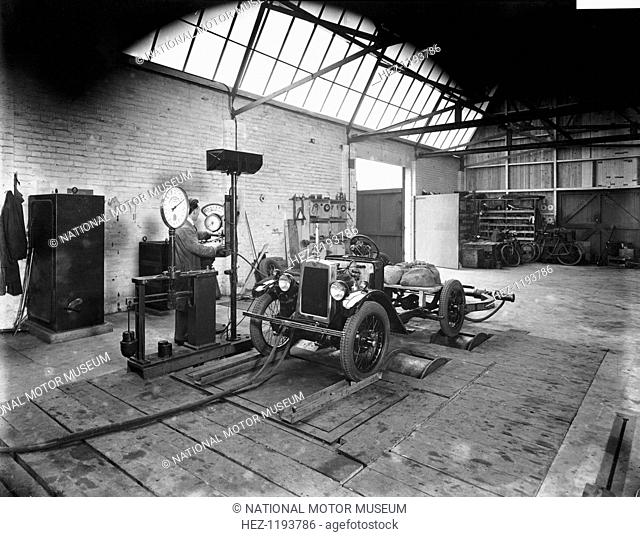 Morris Minor on test, Cowley, Oxfordshire, c1930. A man testing a chassis in a garage