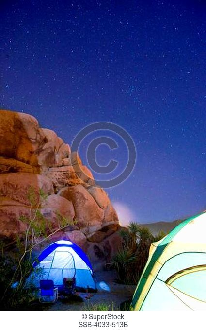 Dome tents lit up at night, Joshua Tree National Monument, California, USA
