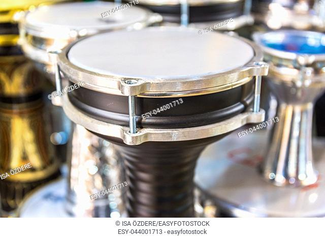 Traditional Turkish instrument darbuka (drum) among other drums. Selective focus