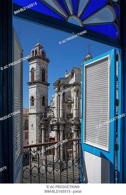 Balcony doors overlooking cityscape, Havana, Cuba