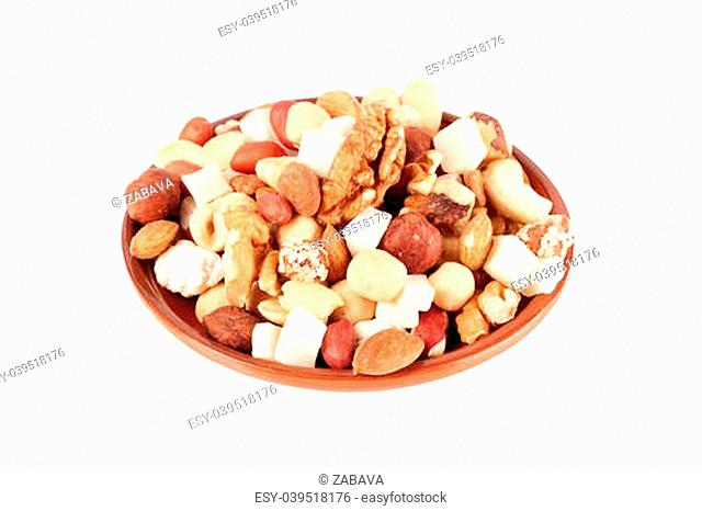 Sweet mix of nuts and dried fruits, isolated over white