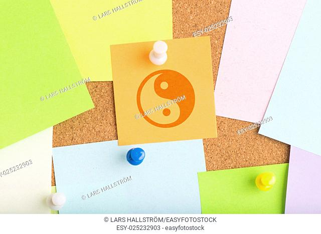 Yin yang symbol on notice board in office. Concept image of harmony, balance and