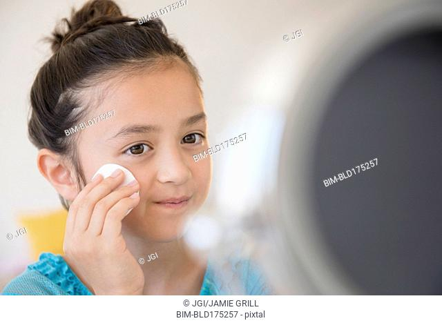 Girl washing her face