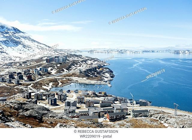 High angle view of residential district by sea during winter