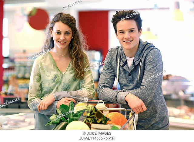 Teenager couple shopping in an organic grocery store