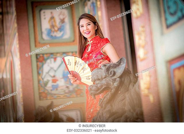 Asian Chinese woman in Traditional Chinese holding blow,by background ambience China