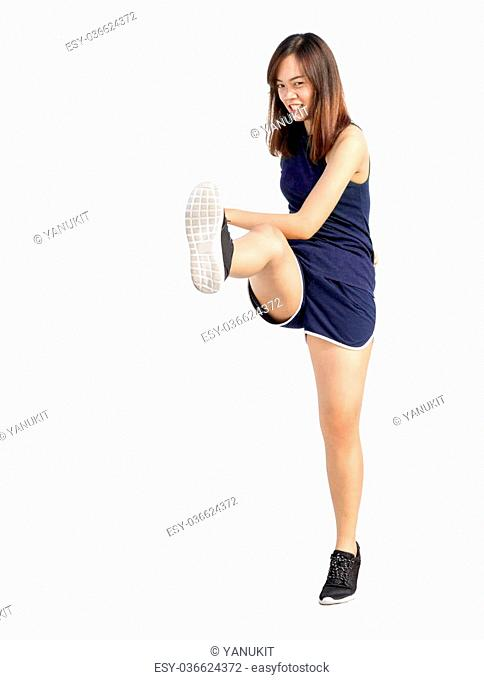 asian lady exercise in kick action on white