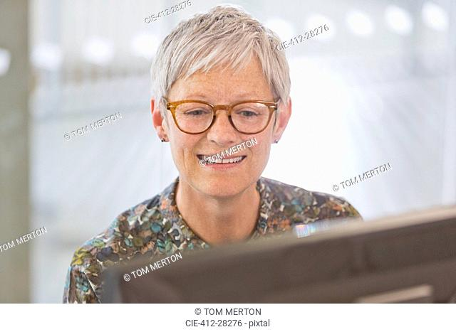 Senior businesswoman working at computer