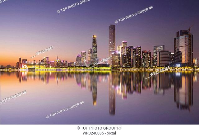 The mirror reflection of the city skyline; Guangzhou Tianhe Central Business District;Guangzhou;China