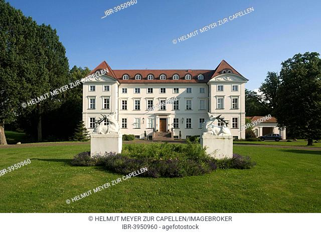 Main façade and grounds of Schloss Wedendorf Castle, built in 1679, rebuilt in the neo-classical style in 1810, now a hotel, Wedendorf