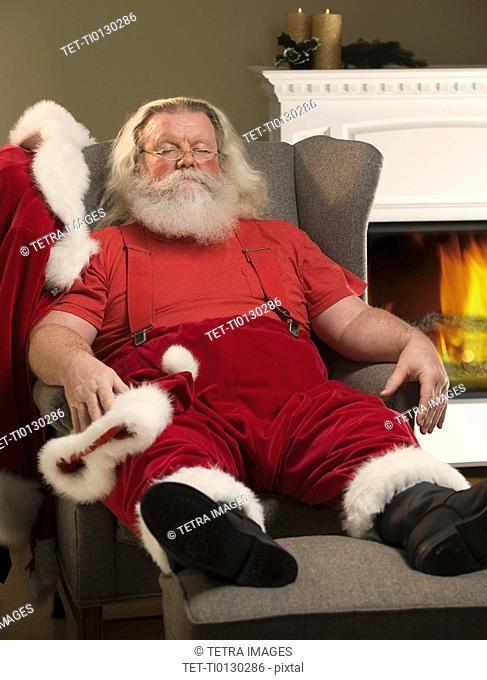 Santa Claus relaxing in armchair