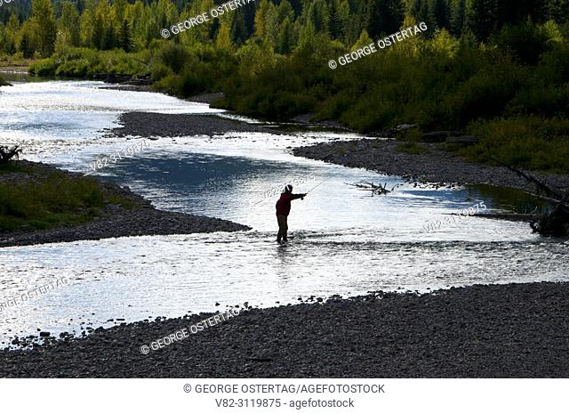 Middle Fork Flathead Wild and Scenic River silhouette with fisherman, Great Bear Wilderness, Flathead National Forest, Montana