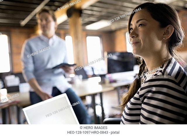 Businesswoman with laptop in meeting