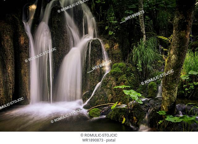 Waterfall in a forest, Plitvice Lakes, Croatia