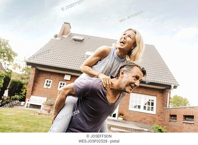 Happy mature couple in garden of their home