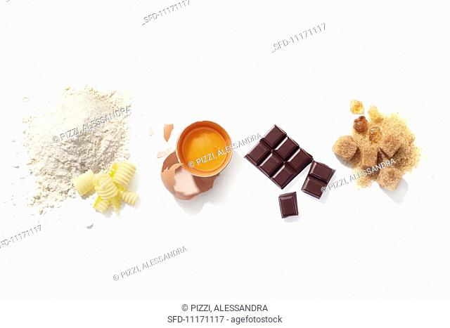 Assorted baking ingredients (flour, butter, egg, chocolate and sugar)