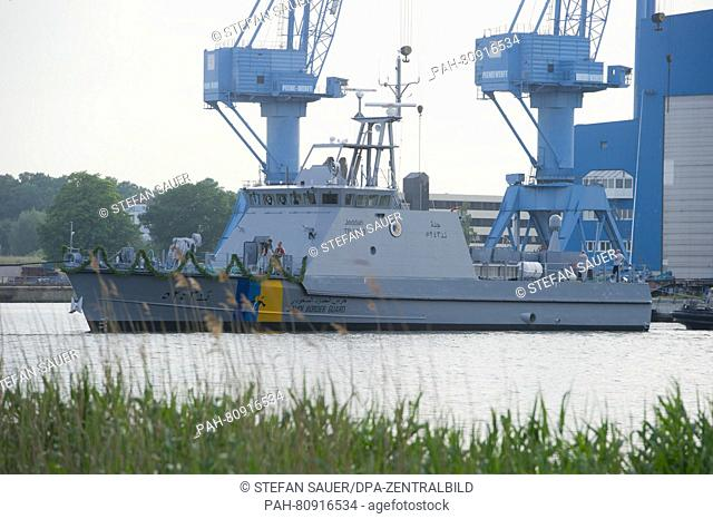 The first coastal defense ship for Saudi-Arabia being pulled dowards the outfitting quay after the launch at Peene dockyard of the Luerssen group in Wolgast