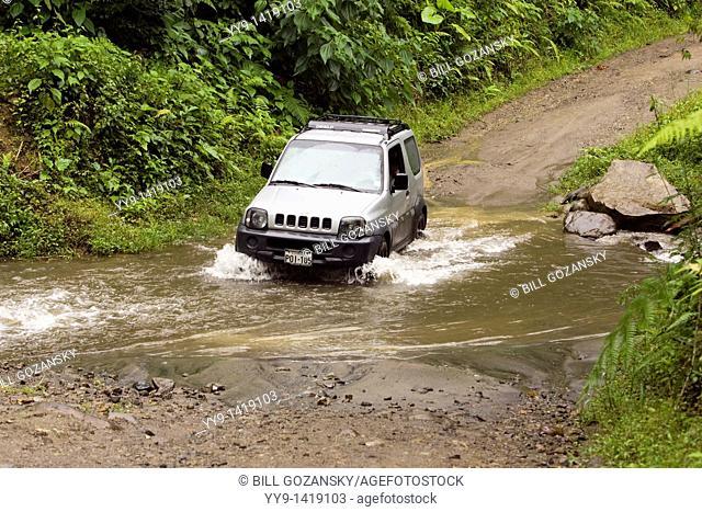 Vehicle crossing small stream - near Refugio Paz de las Antpittas - Nanegalito, Ecuador