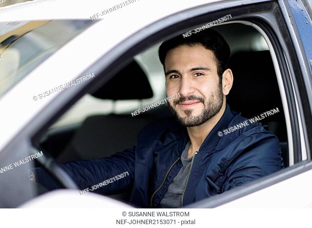 Smiling man in car