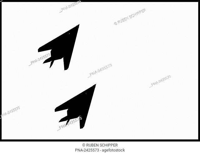 two stealth bombers in flight