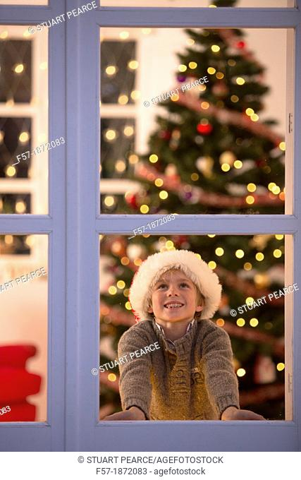 Young boy waiting for santa claus