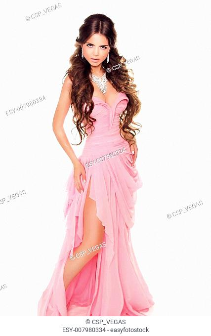 Full-length portrait of a lovely woman in romantic pink dress isolated on white background