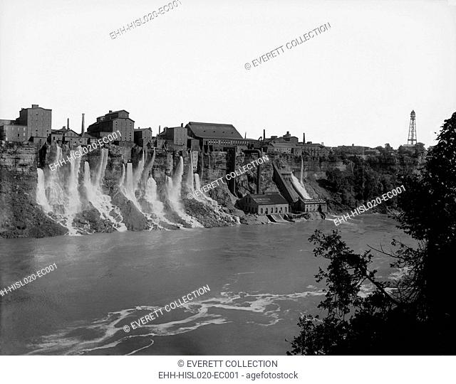 A cluster of factories built on and into the walls of the Niagara River Gorge. Water diverted from above the great Niagara Falls flows from the factories power...