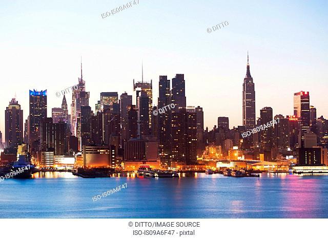 Manhattan skyline and waterfront at dusk, New York City, USA