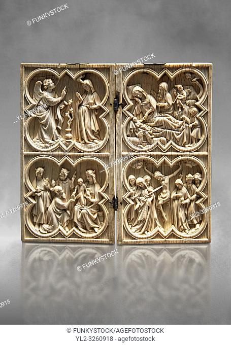 Medieval Gothic ivory diptych depicting the Annunciation, Nativity, the adoration of the Magi and the crucifixion made in Paris in second quarter of the 14th...