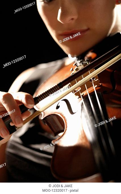 Woman Playing Violin close-up