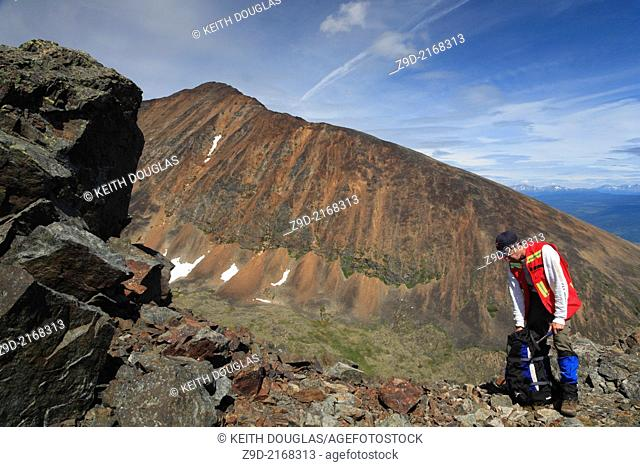 Geologist exploring for minerals, Hudson Bay Mountain, Smithers, British Columbia