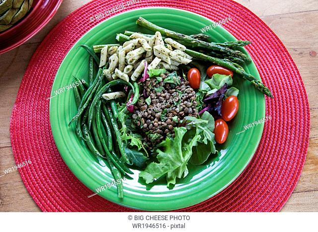 Plate of pasta, lentils, and fresh vegetables