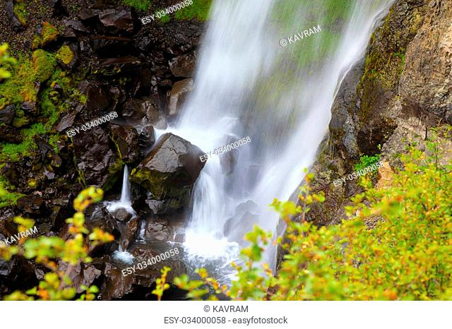 Picturesque waterfall Svartifoss in Skaftafell National Park of Iceland. Black stones in streams of water