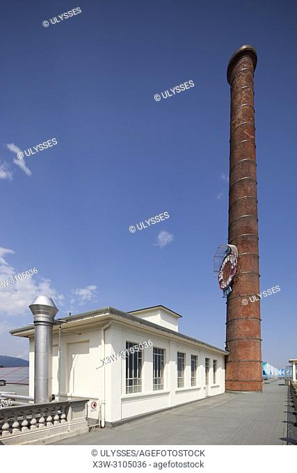 Terraces of the Wool Factory Ermenegildo Zegna and the historical chimney with the trademark, Trivero, Biella, Piemonte, Italy, Europe