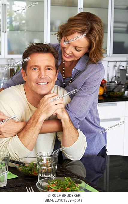 Caucasian couple eating salad