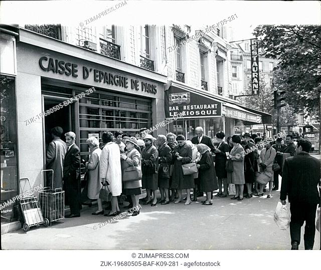 May 05, 1968 - The French Crisis - Paralysis Hits Paris As The Nation-Wide Strikes Spreads. Photo shows Parisians form queues outside to draw money before the...