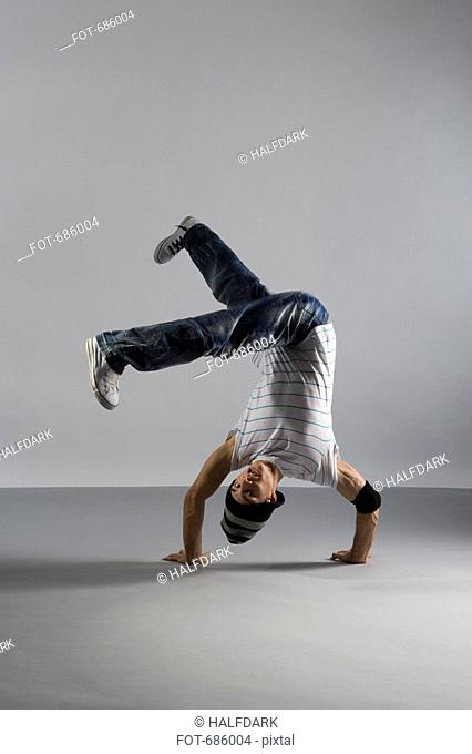 A B-boy doing a Handstand Freeze breakdance move
