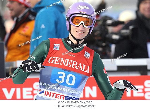 Martin Schmitt of Germany reacts after his competition jump for the second stage of the Four Hills ski jumping tournament in Garmisch-Partenkirchen, Germany