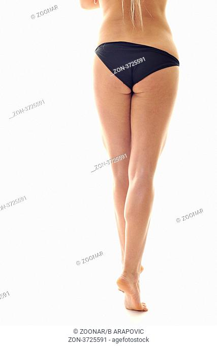 beautiful and attractive young woman bootom and nice legs from back isolated on white
