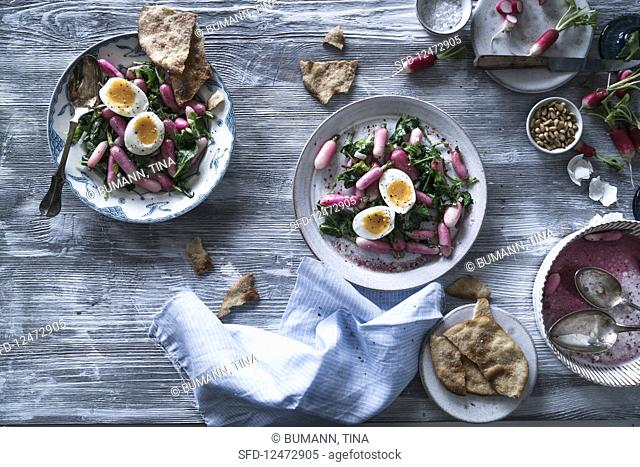 Warm radish salad with egg and unleavened bread (seen from above)