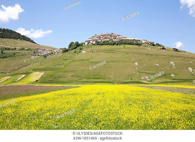landscape wiyh the village of castelluccio di norcia, umbria, italy, europe