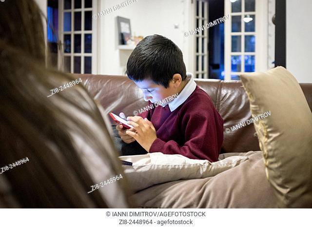 Schoolboy,7,playing games on smart phone