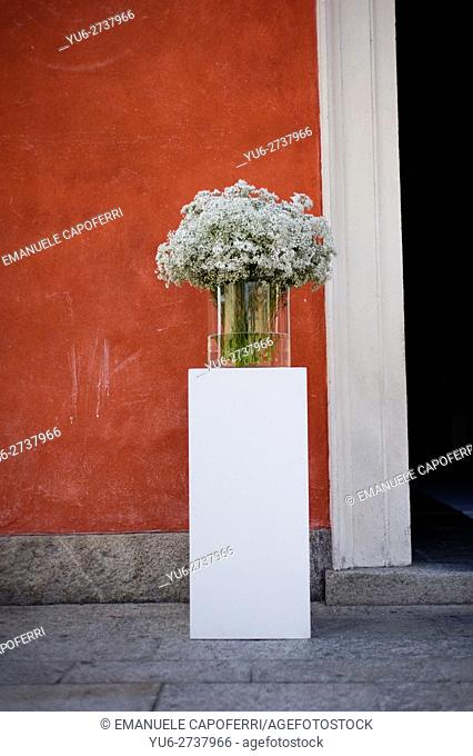 Flowers outside a church, floral arrangements for wedding celebration