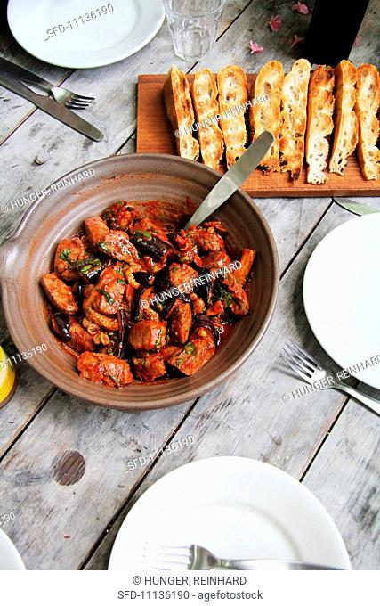 Lamb with aubergines, tomatoes, herbs and bread