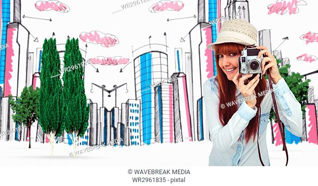 Digitally generated image of female tourist holding camera with buildings in background