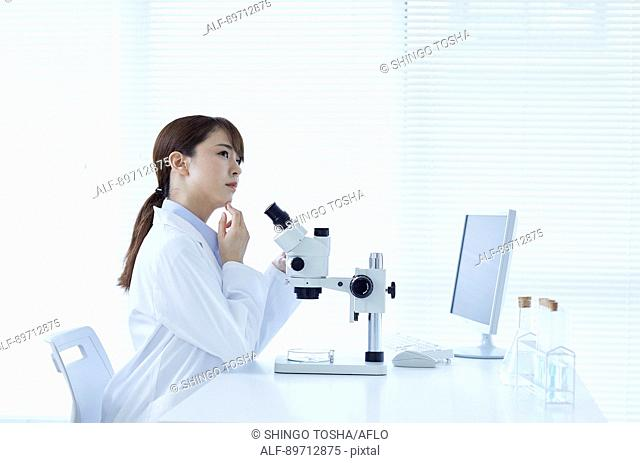 Young Japanese researcher in the lab