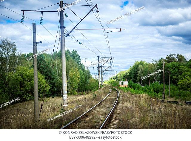 Railway tracks near Mashevo abandoned village of Chernobyl Nuclear Power Plant Zone of Alienation area around nuclear reactor disaster in Ukraine