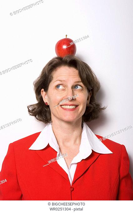 Apple sitting on businesswomans head