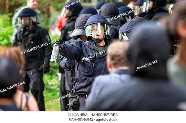 Police use pepper spray on left wing counter-protester in Berlin, Germany, 26 April 2014. Several thousand people protest the extreme right National Democratic...
