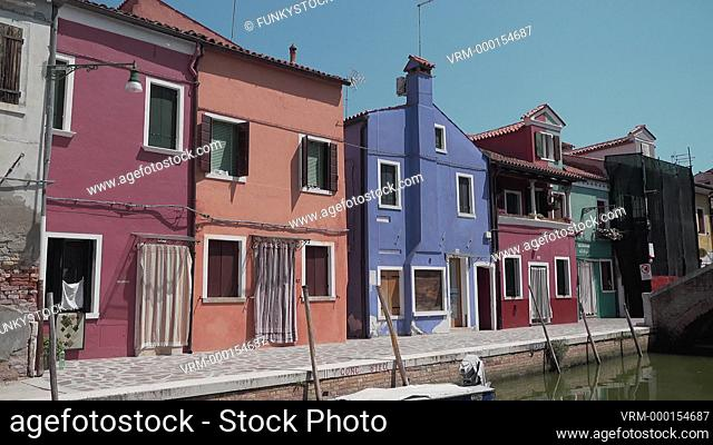 The traditional colourful houses and canal of Burano Island, Venice Lagoon, Italy